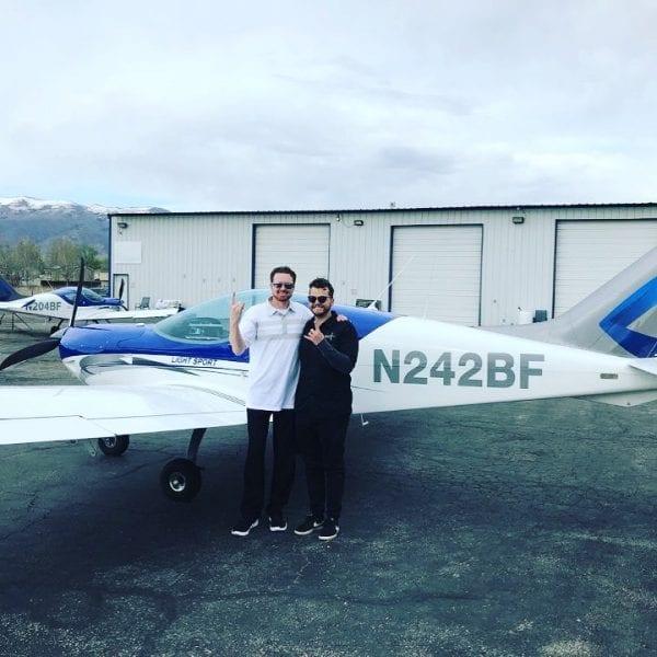 men in front of plane