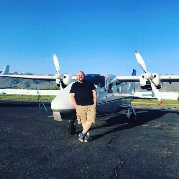 man in front of plane