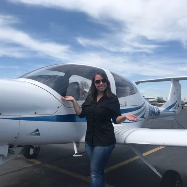 woman in front of plane