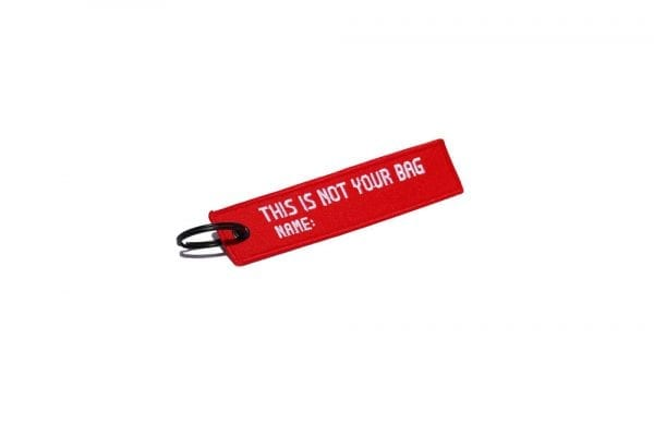 """FLT Keychain with words """"This is not your bag"""""""