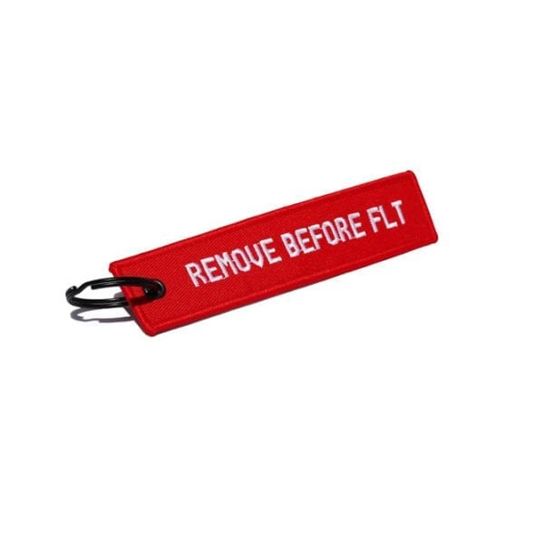 """Keychain with words """"Remove before FLT"""""""