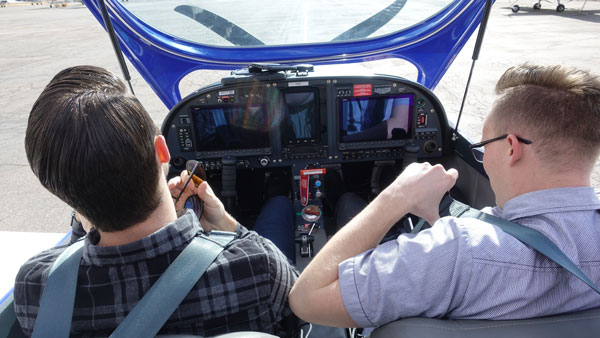 Pilot and Student sitting in small plane