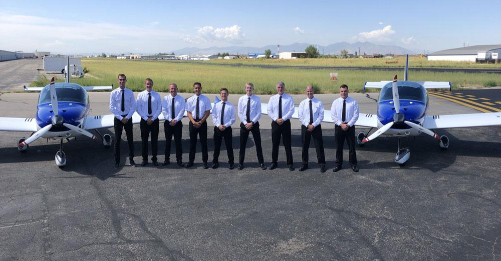 FLT students standing between planes